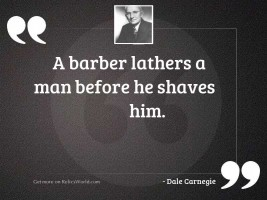 A barber lathers a man