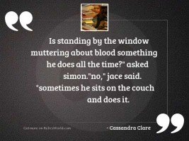 Is standing by the window